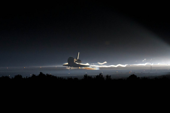 Space shuttle Atlantis (STS-135) touches down at NASA's Kennedy Space Center Shuttle Landing Facility (SLF), completing its 13-day mission to the International Space Station (ISS) and the final flight of the Space Shuttle Program, early Thursday morning, July 21, 2011, in Cape Canaveral, Fla.