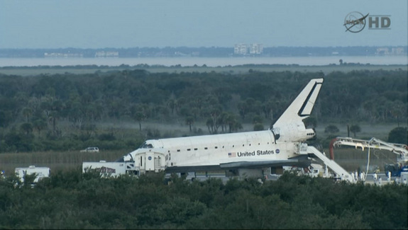 Space shuttle Atlantis is seen on the runway after making a predawn landing at NASA's Kennedy Space Center on July 21, 2011 to end the agency's 30-year shuttle program. It was the 135th and final shuttle flight.