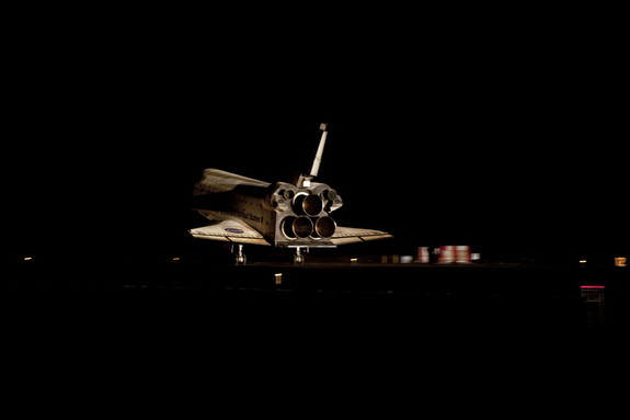 Space shuttle Atlantis gleamed in the darkness at it touched down on the Shuttle Landing Facility's Runway 15 at NASA's Kennedy Space Center in Florida for the final time. Atlantis' wheels came to a stop at 5:57:54 am on Thursday, July 21, 2011.