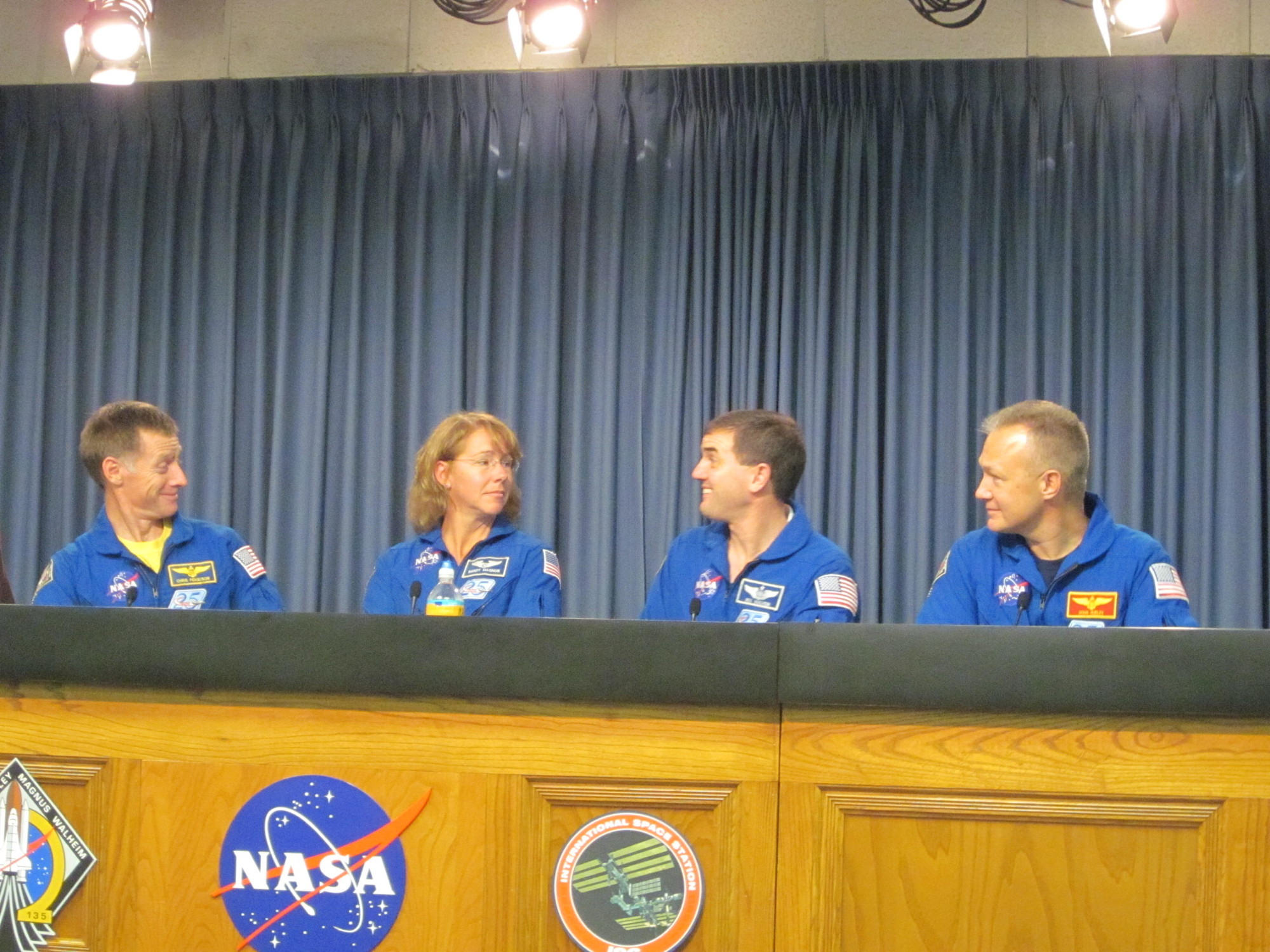 Atlantis Crew Seated at Desk During Post-Landing Press Conference