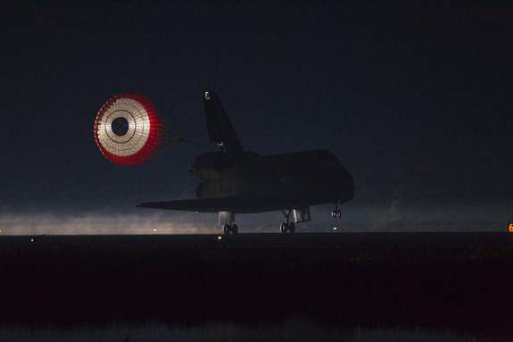 At the Shuttle Landing Facility at NASA's Kennedy Space Center in Florida, the drag chute trailing space shuttle Atlantis is illuminated by the xenon lights on Runway 15 as the shuttle lands for the final time. Securing the space shuttle fleet's place in history, Atlantis marked the 26th nighttime landing of NASA's Space Shuttle Program and the 78th landing at Kennedy.