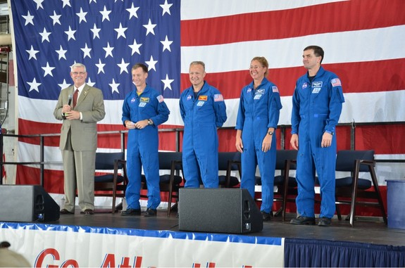 The final space shuttle crew members appear at their Houston homecoming. Left to right: Johnson Space Center director (and former astronaut) Mike Coats, commander Chris Ferguson, pilot Doug Hurley, and mission specialists Sandra Magnus and Rex Walheim.