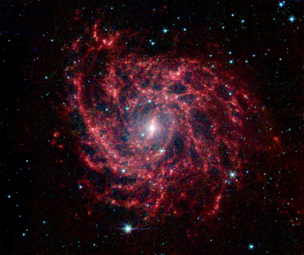 Spiral Galaxy Glows Like a Cosmic Spider Web