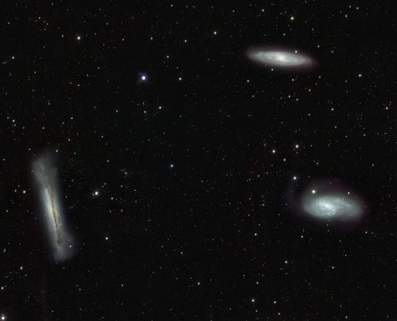 Triplet of bright galaxies in the constellation of Leo (The Lion), together with a multitude of fainter objects: distant background galaxies and much closer Milky Way stars. The image hints at the power of the VST and OmegaCAM for surveying the extragalactic Universe and for mapping the low brightness objects of the galactic halo.
