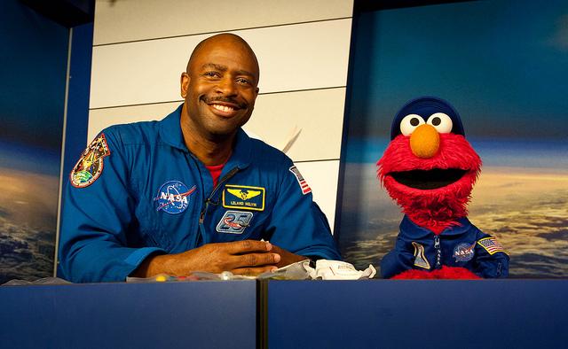 Elmo and Former Astronaut Leland Melvin