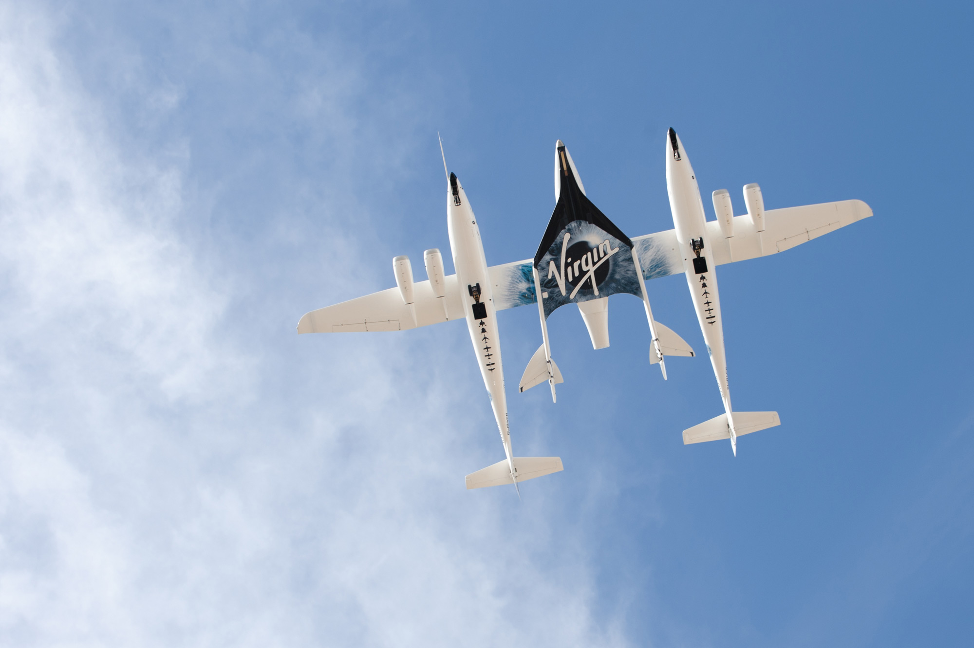 WhiteKnightTwo and VSS Enterprise Fly over the Spaceport