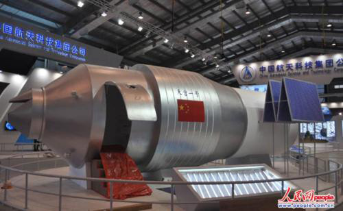 Display model of Tiangong I module at an exhibition hall at the China Academy of Space Technology, complete with access door for public viewing. A Long March 2F carrier rocket for Tiangong I arrived at China's Jiuquan Satellite Launch Center on July 23. Personnel and facilities from all subsystems and payloads are gathering at the launch center for the mission of the space laboratory, which are reportedly going well.