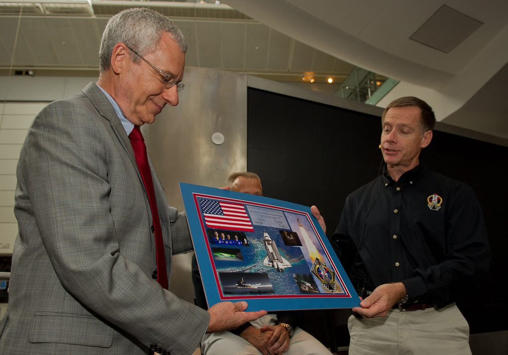 STS-135 Commander Chris Ferguson Presents Montage to Make Shara, Curator, Department of Astrophysics, American Museum of Natural History