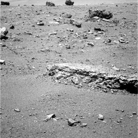 "The flat-topped rock just below the center of this raw image from the rover Opportunity's panoramic camera was chosen by the rover team in August 2011 as a stop for inspecting with tools on Opportunity's robotic arm. This image was taken during the 2,688th Martian day, or sol, of Opportunity's work on Mars (Aug. 16, 2011), which was seven days after the rover arrived at the western rim of Endeavour Crater. The rock, informally named ""Tisdale 2,"" displays a different texture than rocks that Opportunity has seen during the rovers' first 90 months on Mars."