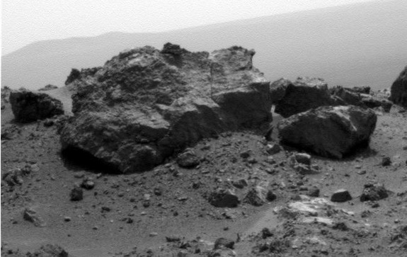 "The large rock ""Ridout"" dominates this photo taken by NASA's Mars rover Opportunity on Aug. 13, 2011 near the rim of the giant Endeavour crater on the Red Planet. Ridout rock is on the edge of a smaller crater, Odyssey, on the rim of Endeavour."