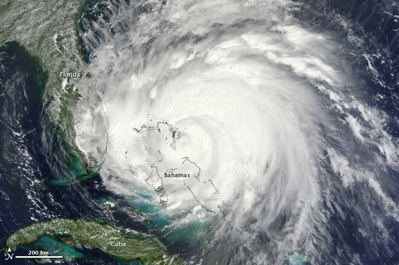 Hurricane Irene is a large and dangerous storm. In this image, taken by the Moderate Resolution Imaging Spectroradiometer (MODIS) on the Terra satellite on August 25, 2011, bands of thunderstorms spiral tightly around a dense center, forming the circular shape of a well-developed hurricane.