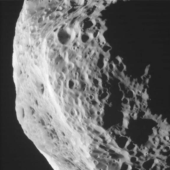 This side view taken by NASA's Cassini spacecraft of Saturn's moon Hyperion reveals craters and other battered surface features. This photo was taken during Cassini's Aug. 25, 2011 flyby of Hyperion.