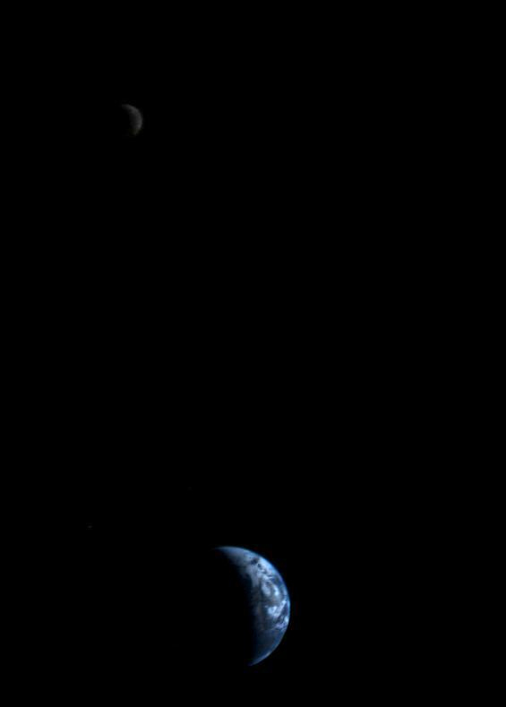 This picture of a crescent-shaped Earth and moon -- the first of its kind ever taken by a spacecraft -- was recorded Sept. 18, 1977, by NASA's Voyager 2 when it was 7.25 million miles (11.66 million kilometers) from Earth. Because the Earth is many times brighter than the moon, the moon was artificially brightened so that both bodies would show clearly in the prints.