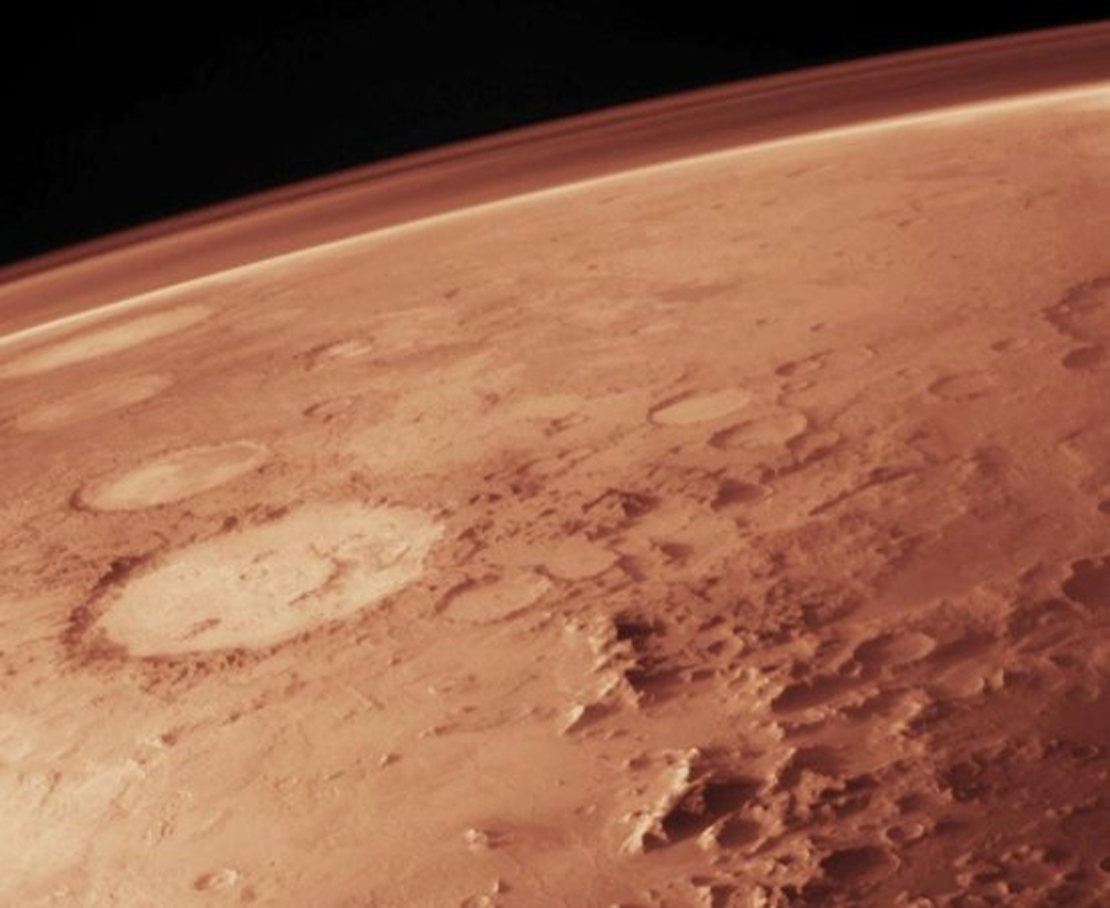The thin atmosphere of Mars today composed mainly of carbon dioxide as depicted in this artist's illustration
