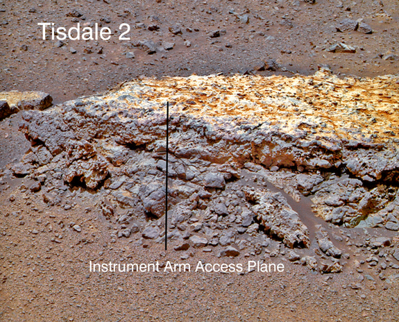 "This rock, informally named ""Tisdale 2,"" was the first rock NASA's Mars rover Opportunity examined in detail on the rim of Endeavour Crater. It has textures and composition unlike any rock the rover examined during its first 90 months on Mars. Its characteristics are consistent with the rock being a breccia — a type of rock fusing together broken fragments of older rocks."