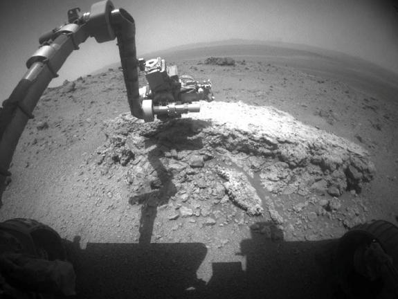 "NASA's Mars Exploration Rover Opportunity used its front hazard-avoidance camera to take this picture showing the rover's arm extended toward a light-toned rock, ""Tisdale 2,"" during the 2,695th Martian day, or sol, of the rover's work on Mars (Aug. 23, 2011)."