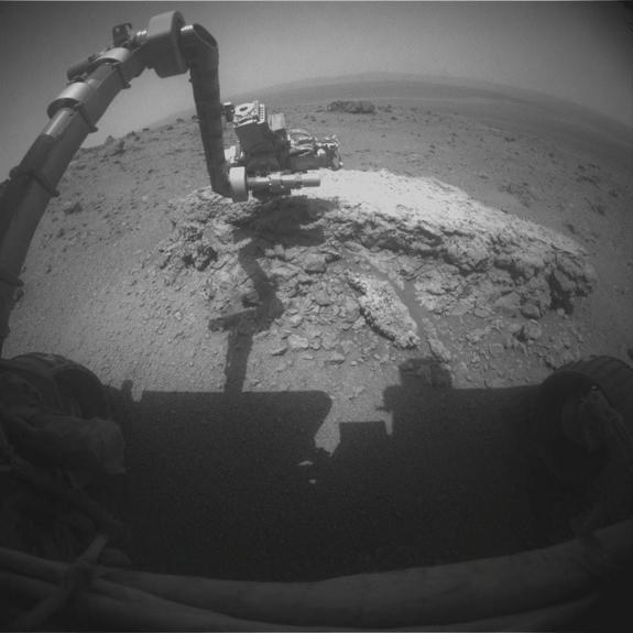 "NASA's Mars rover Opportunity used its front hazard-avoidance camera to take this picture showing the rover's arm extended toward a light-toned rock, ""Tisdale 2,"" during the 2,695th Martian day, or sol, of the rover's work on Mars (Aug. 23, 2011). Tisdale 2 is about 12 inches (30 cm) tall."
