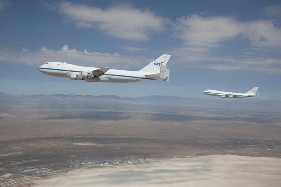 NASA's modified Boeing 747 Shuttle Carrier Aircraft briefly flew in formation over the Edwards Air Force Base Test Range on Aug. 2, 2011.