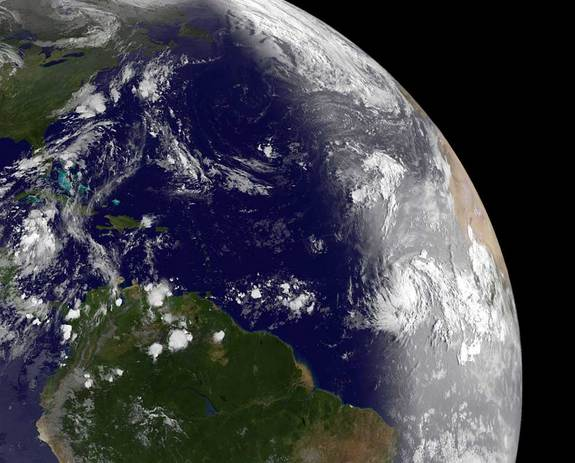 When the  GOES-13 satellite passed over Katia (right, center) on Aug. 30, 2011, just after daylight reached it in the Atlantic, it revealed a well-developed storm. The bright vertical line on the Earth shows daylight to the east of the line, and imagery is visible.