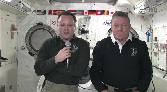 Space station astronauts Ron Garan (left) and Mike Fossum talk to reporters Sept. 6.