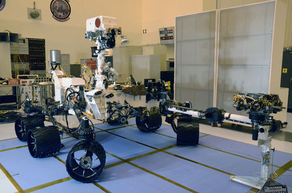 The next time the Curiosity Mars Science Laboratory be in this same configuration — wheels deployed and remote sensing mast and instrument-tipped arm extended — will be after it is deposited on the surface of Mars in August 2012.