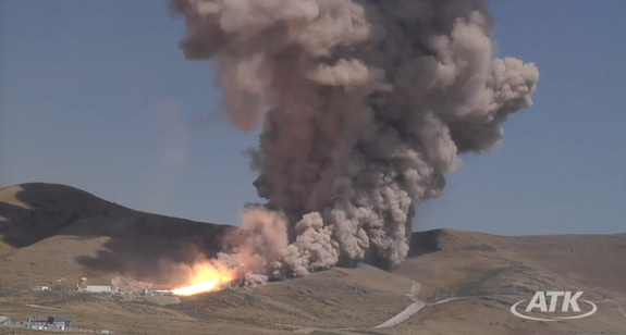 This still from an ATK webcast shows a wide view of the five-segment solid rocket booster DM3 during a Sept. 8, 2011 static test firing at the company's motor proving grounds near Promontory, Utah.