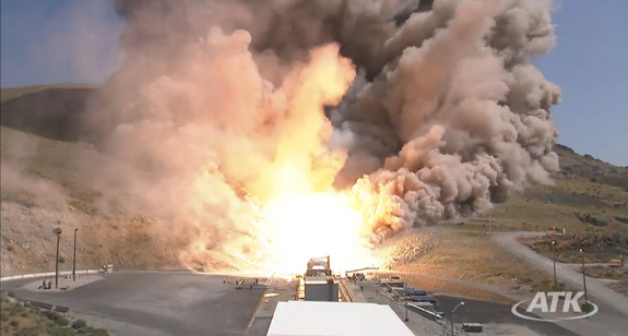 This still from an ATK webcast shows a top-down view of the five-segment solid rocket booster DM3 during a Sept. 8, 2011 static test firing at the company's motor proving grounds near Promontory, Utah.