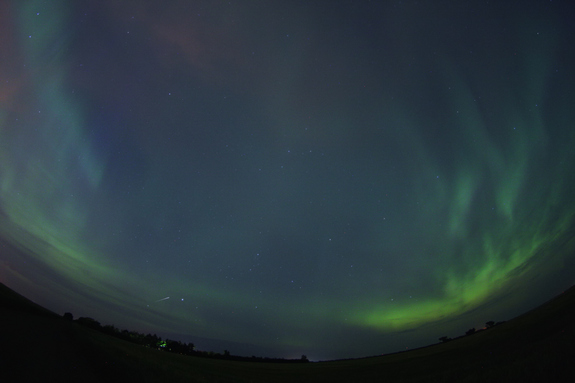 Skywatcher and photographer Colin Chatfield snapped this amazing aurora view on Aug. 5, 2011 from just outside Saskatoon in Saskatchewan, Canada, using a Canon 40D and Tokina 10-17mm fisheye lens. A meteor and eerie blue hue are visible in the upper left.