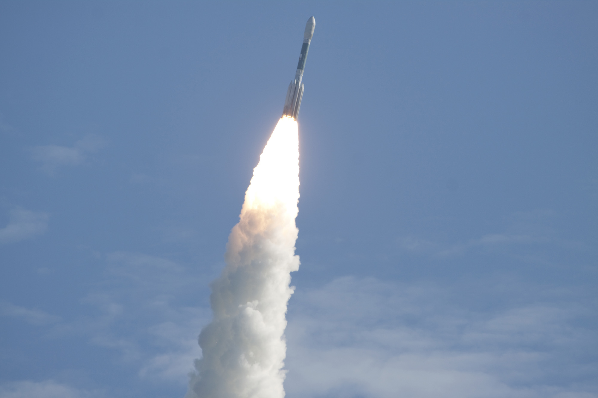 Fla. – Fire and smoke light up a blue sky as a United Launch Alliance Delta II Heavy rocket propels NASA's Gravity Recovery and Interior Laboratory (GRAIL) mission into space on Sept. 10, 2011.