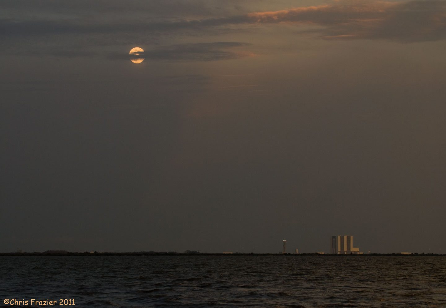 The Moon and the Vehicle Assembly Building