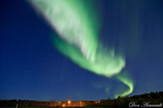 A twisting ribbon of bright green light dominates this view of the dazzling Sept. 9, 2011 northern lights display captured by photographer and skywatcher Don Arsenault in northern Alberta, Canada.