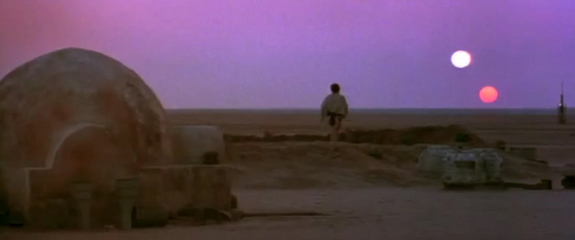 Film still from 'Star Wars Episode IV: A New Hope' showing the sunset on the planet Tatooine.