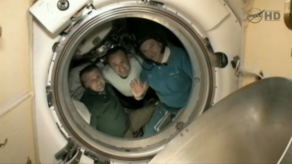 American astronaut Ron Garan (center) and his two Russian crewmates Alexander Samokutyaev (waving) and Andrey Borisenko bid farewell to the International Space Station on Sept. 15, 2011 before undocking from the outpost and returning to Earth.
