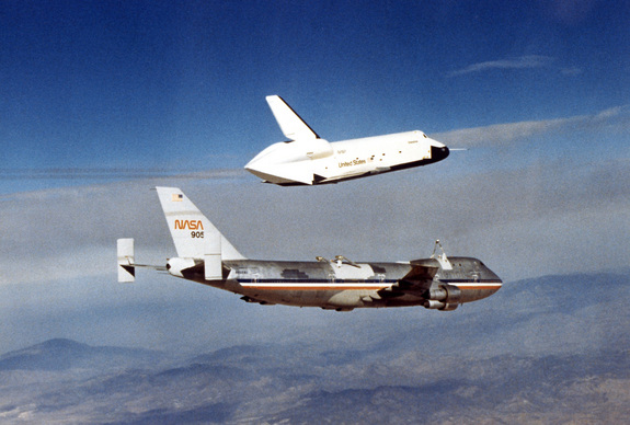 The Space Shuttle prototype Enterprise flies free of NASA's 747 Shuttle Carrier Aircraft (SCA) during one of five free flights carried out at the Dryden Flight Research Facility, Edwards, California in 1977 as part of the Shuttle program's Approach and Landing Tests (ALT).