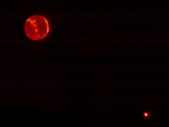 This shot, taken in infrared light using the adaptive optics system at Hawaii's Keck Observatory, shows Neptune and its moon Triton (lower right).