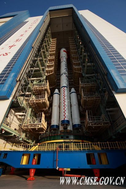 China's integrated Tiangong 1 spacecraft and Long March 2F rocket is slowly rolled out of the vehicle assembly building to its launch site.