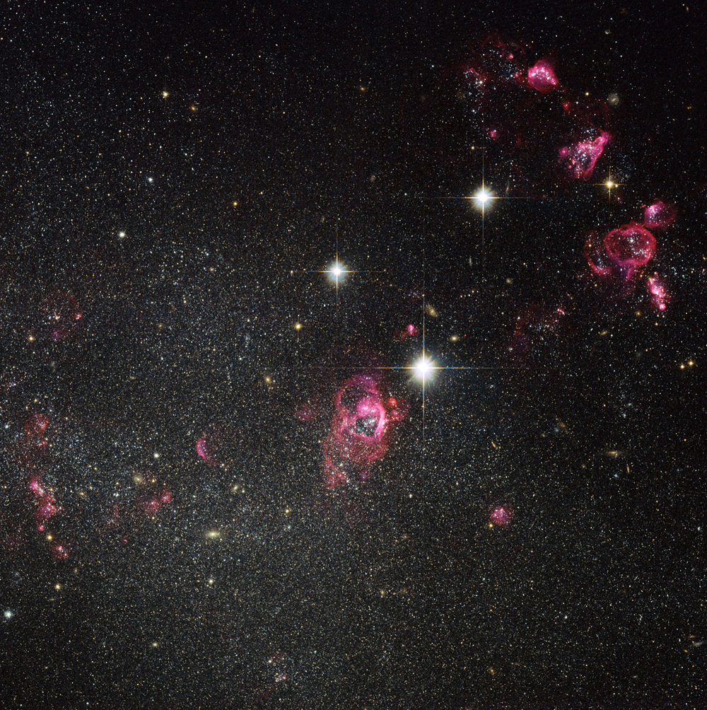 Hubble Photo of Galaxy Holmberg II Blowing Bubbles