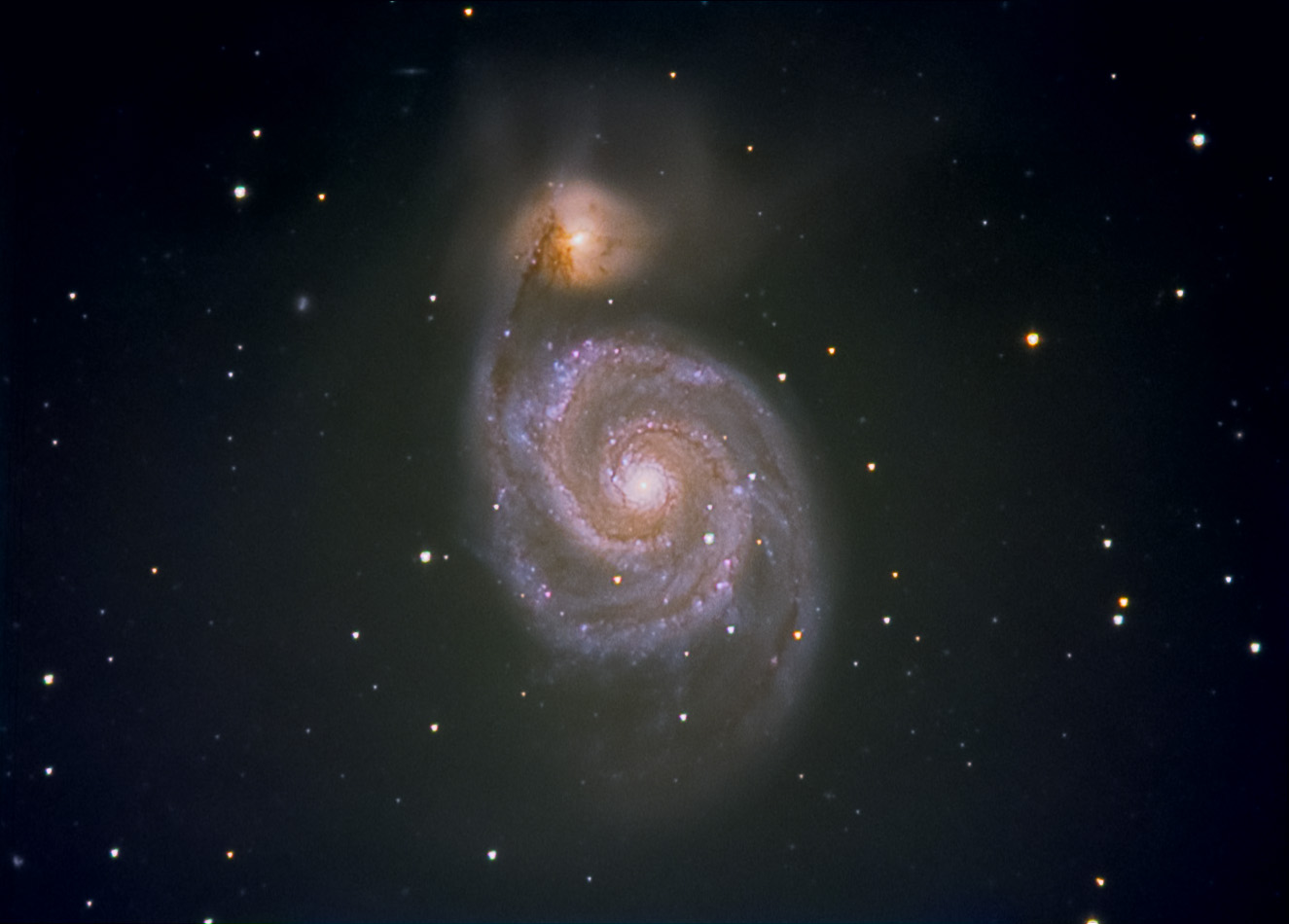 Swirls in Space: Whirlpool Galaxy Shines in Skywatcher Photo