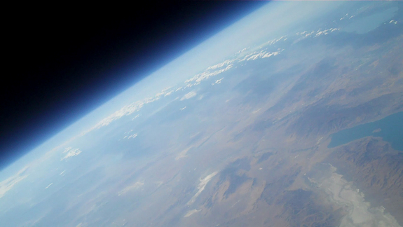 An amateur rocket launched by Team Qu8k looks down at Earth from about 120,000 feet up.