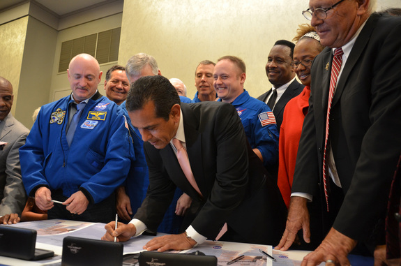 Los Angeles mayor Antonio Villaraigosa signs the title transfer for space shuttle Endeavour during a ceremony at the California Science Museum on Oct. 11, 2011. Endeavour will be permanently displayed at the science center for the public to see after delivery in 2012.
