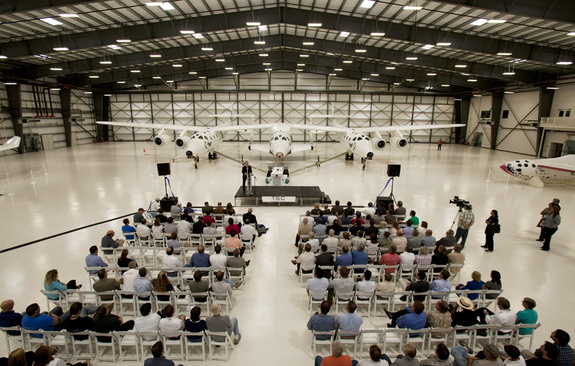 Onlookers take part in Sept. 19, 2011 ceremonies at the Mojave Air and Space Port. The Final Assembly, Integration and Test Hangar is designed to put together spaceships for Virgin Galactic.