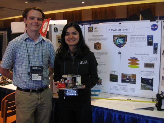 Drexel University Space Systems Lab students Kenneth Mallory and Swati Maini showcase their smallsat at last month's Small Satellite Conference in Logan, Utah.