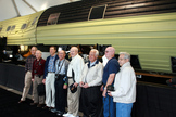 Phil Pressel (fourth from left) joins other National Reconnaissance Office veterans in a group photograph in front of the 60-foot long KH-9 HEXAGON spy satellite. This gathering of former NRO contractors was finally able to share stories of their once-secret work with family and friends at a celebration marking the NRO's 50th anniversary. The KH-9 was declassified and displayed at the Smithsonian National Air & Space Museum's Udvar-Hazy Center on Sept. 17, 2011.
