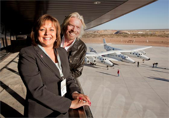 "Sir Richard Branson and New Mexico Governor Susana Martinez dedicate the Terminal Hangar Facility, now dubbed the ""Virgin Galactic Gateway to Space,"" on Oct. 17, 2011. Martinez noted that suborbital space travel would likely be on her ""bucket list."""