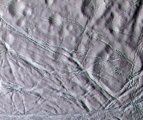 "Cassini color image of ""snowy"" landscape of Enceladus.  This terrain lies north of the geologically active south polar ridges and features a rolling terrain crosscut by narrow fractures."