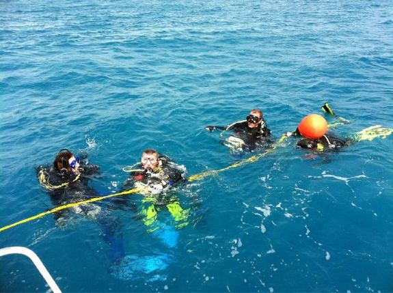 NEEMO 15 crewmembers prepare to dive to the Aquarius Underwater Laboratory on Oct. 20, 2011.