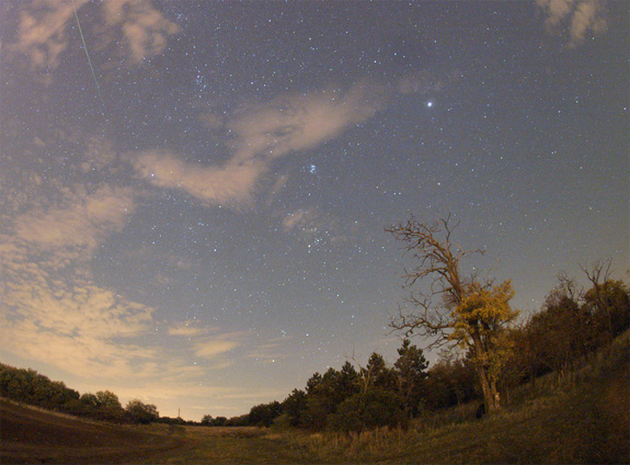 Amateur astronomer Monika Landy-Gyebnar snapped this photo of an Orionid meteor (top left) streaking over a field east of her hometown of Veszprem, Hungary on Oct. 22, 2011 during the peak of the annual Orionid meteor shower.