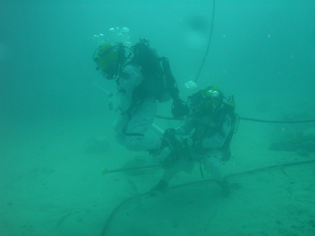 Astronauts Shannon Walker And Steve Squyers Collect Samples