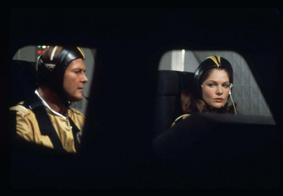 "James Bond and Holly Goodhead sport soft space helmets in ""Moonraker,"" the 1979 Bond film."