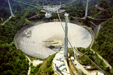 Astronomers use the huge Arecibo Observatory, a radio telescope in Puerto Rico, to study the close flyby of Earth by asteroids.